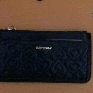 Betsey Johnson wallet with black quilted front.
